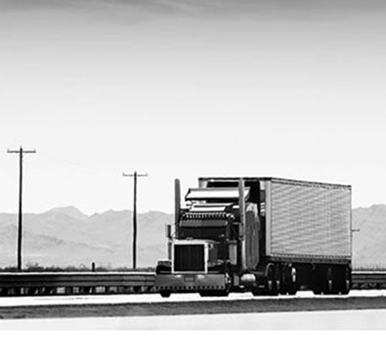 18-wheeler Truck Driving On The Highway Stock Photo