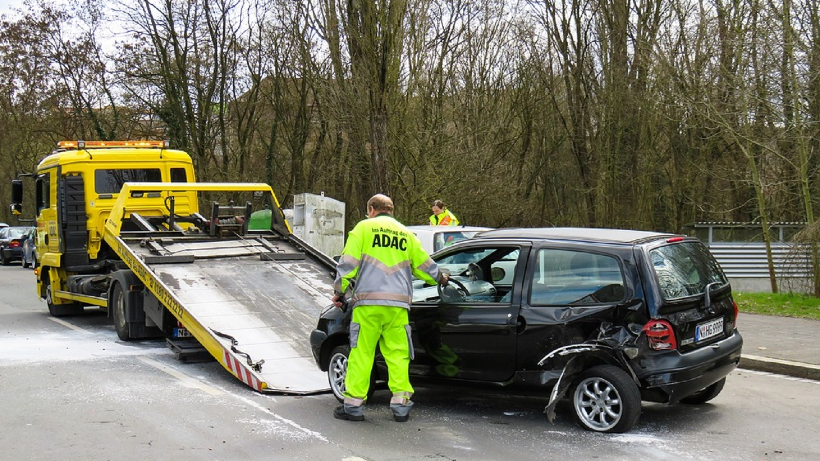 Stock photo of a damaged car being towed away from an accident.