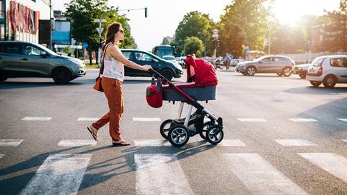 Woman Pushing Baby In Stroller Stock Photo